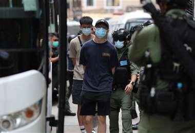Varios detenidos durante la manifestación. Foto AFP