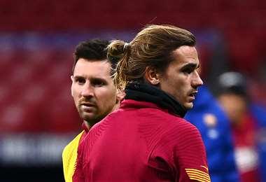Griezmann y Messi, compañeros en el Barcelona. Foto: AFP