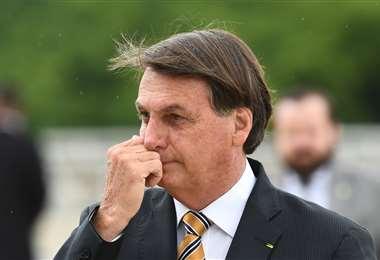 Bolsonaro enfrenta críticas por su manejo de la pandemia /AFP