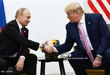 Los mandatarios de Rusia y EEUU en la cumbre del G20 en Japón el año pasado. Foto AFP