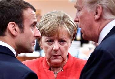 Macron (Francia), Merkel (Alemania) y Trump (Estados Unidos), en reunión del G7