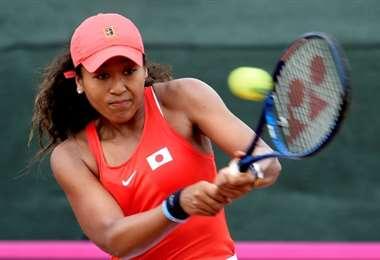 La joven tenista japonesa Naomi Osaka fue la atleta femenina mejor pagada del mundo el último año, según la revista Forbes. Foto: AFP