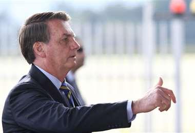El mandatario brasileño insiste en el desconfinamiento. Foto AFP
