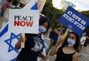 Manifestantes protestan contra los planes del gobierno israelí de anexar tierras de Cisjordania. Foto AFP