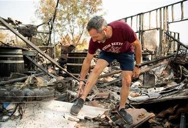 Una vivienda destruida por los incendios. Foto AFP