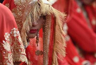 Ceremonia de matrimonio múltiple en India. Foto AFP