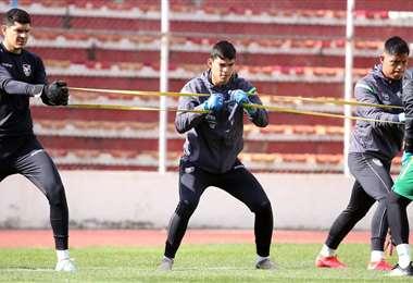 Lampe, Cordano y Roca, en pleno trabajo con la Verde. Foto: Prensa FBF