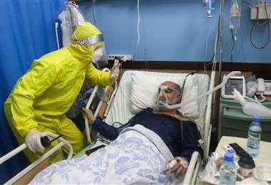 Persona afectada por el Covid. Foto AFP