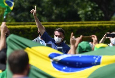 Bolsonaro saluda a sus simpatizantes/AFP