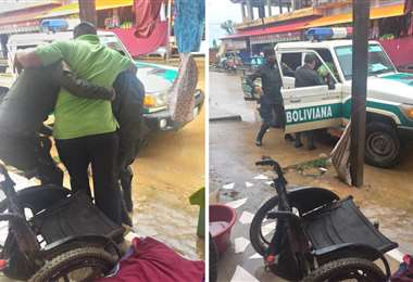 Policía ayudando a un anciano que tenía dificultades para movilizarse en su silla de rueda
