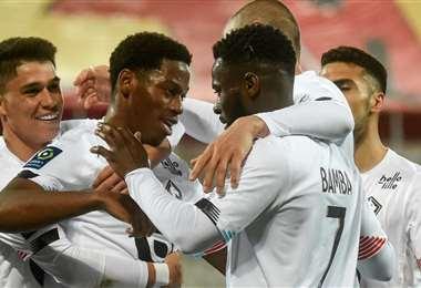 Los jugadores del Lille festejan una victoria clave contra el Lens. Foto: AFP
