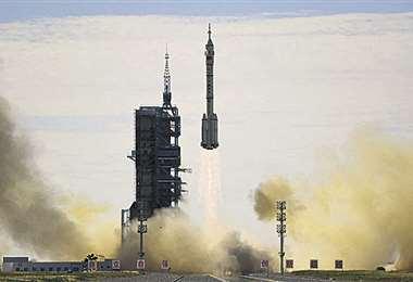 Partida del cohete Larga Marcha. Foto: AFP