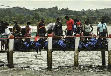 Inusual flujo de migrantes haitianos, africanos, venezolanos y cubanos en Colombia |  AFP